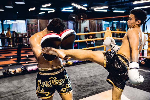 High intensity Muay Thai pad work
